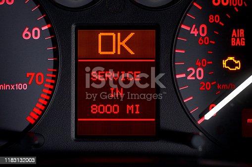 Close-up of a digital car odometer in dashboard