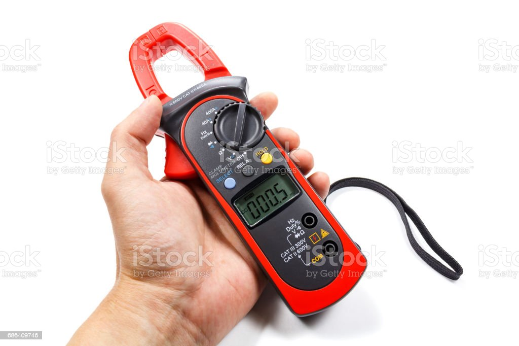 Digital clamp multimeter in man's hand on a white background stock photo