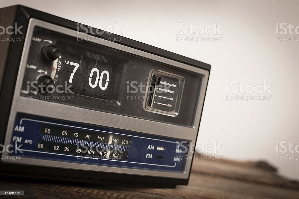 \'Slightly desaturated, color image of an older digital clock radio...