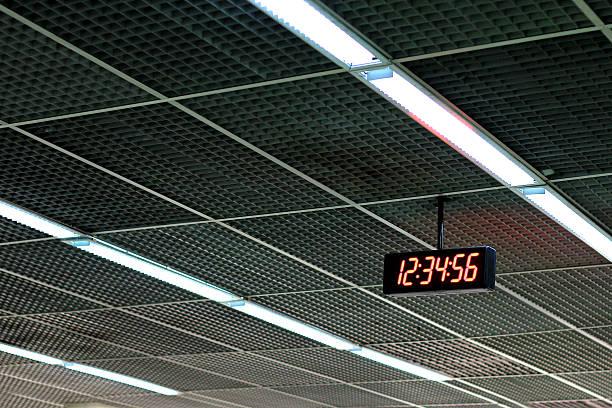 digital clock show time 12:34:56 on the ceiling. - led uhr stock-fotos und bilder