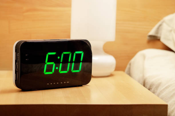 digital clock shows 06.00 am green numbers on digital clock shows 06.00 AM stock pictures, royalty-free photos & images