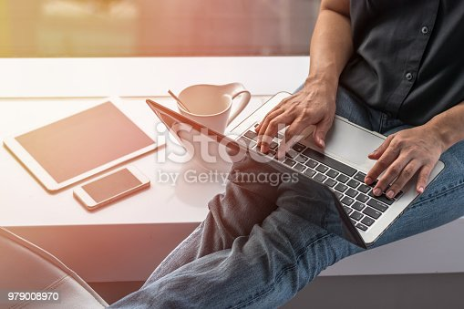 istock Digital communication lifestyle blog writer person using mobile smart device, or woman user typing on computer laptop working online via wireless internet technology 979008970