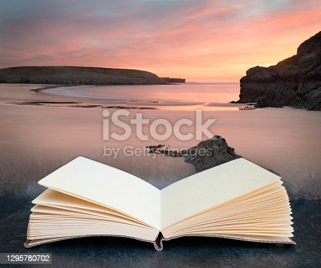 Digital composite of Stunning sunrise landsdcape of idyllic Broadhaven Bay beach on Pembrokeshire Coast in Wales in pages of open book
