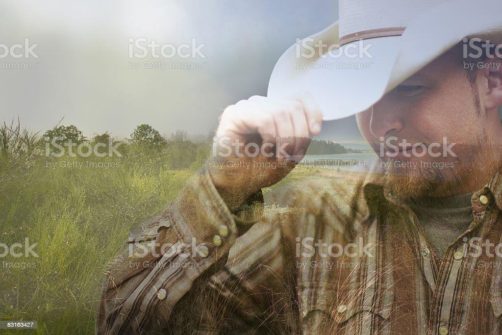 Image composite numérique de cow-boy et le littoral photo libre de droits