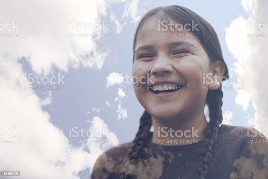 Composizione digitale di ridere ragazza e nuvole foto stock royalty-free