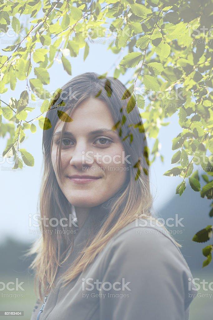 Digital composite of woman and tree branches royaltyfri bildbanksbilder
