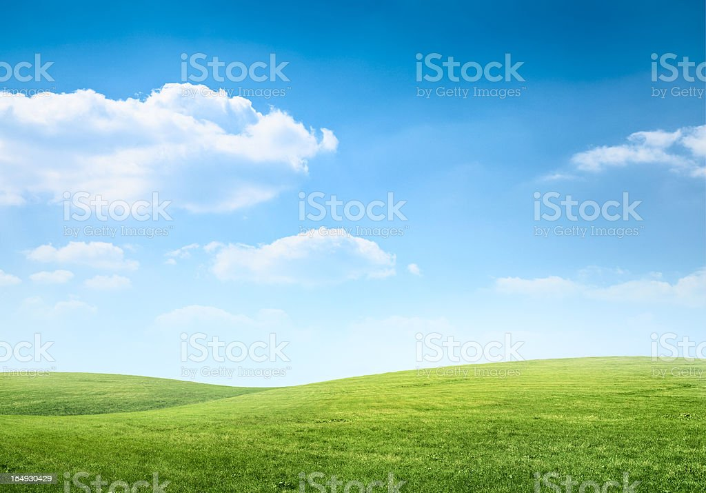 Digital composition of green meadow and blue sky stok fotoğrafı