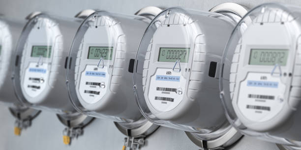 Digital electric meters in a row measuring power use. Electricity consumption concept. stock photo