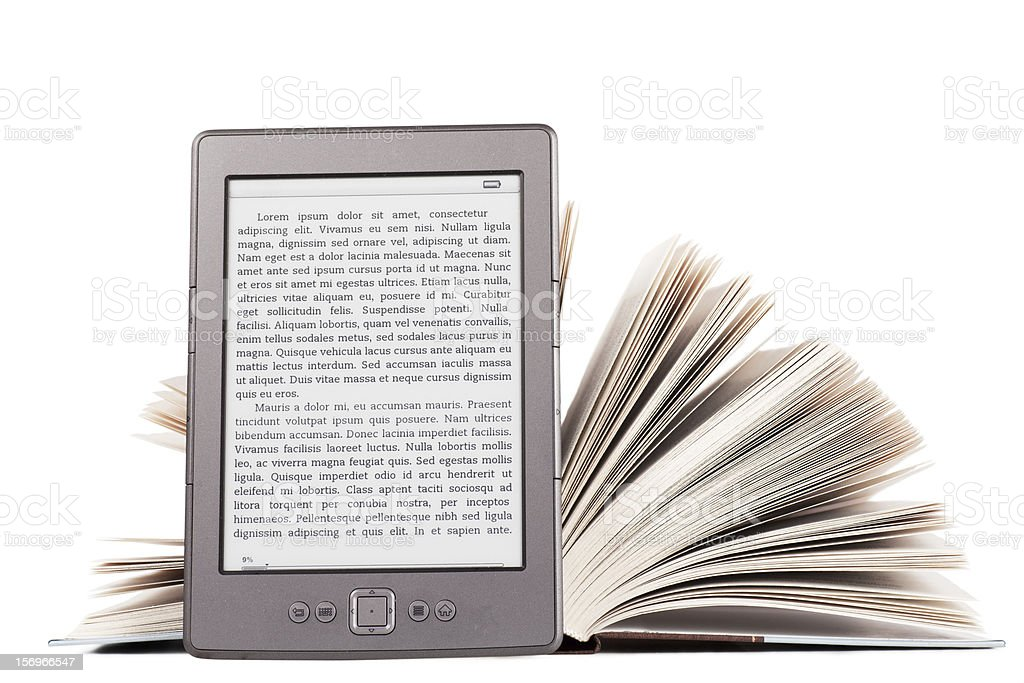 A digital e-reader against a hardback book stock photo