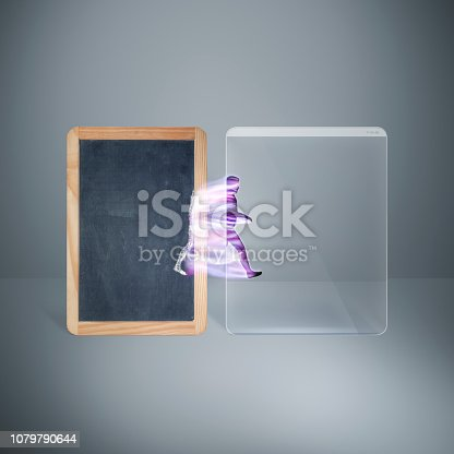 Digital revolution concept with copy space for design and text. From blackboard to modern digital tablet.