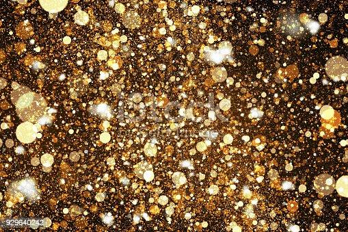 846933050istockphoto Digital golden sparkling dust texture 929640242