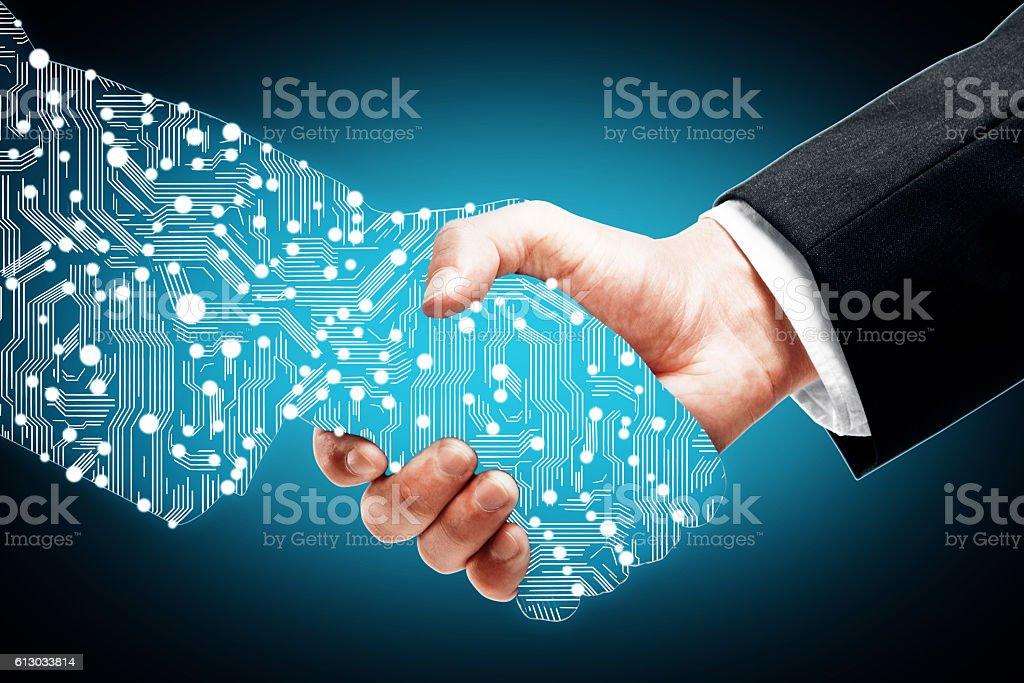 Digital handshake on blue background stock photo