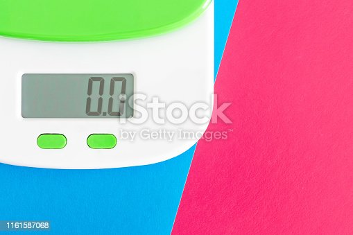 istock Digital kitchen scale on color background. 1161587068