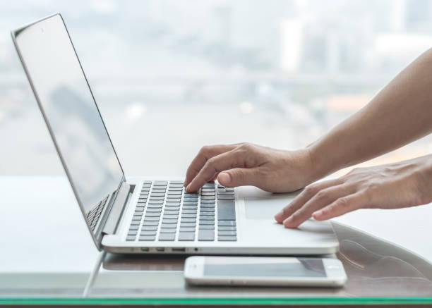 Digital lifestyle blog writer or business person using smart device working on internet communication technology stock photo