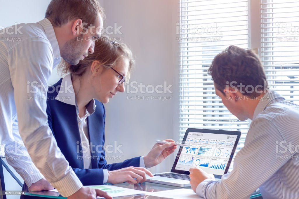 Digital marketing analyst people working on internet advertisement campaign analytics data on key performance indicator dashboard, metrics and KPI on computer screen, business strategy, investment stock photo