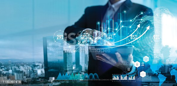 Digital marketing. Business strategy. Businessman using tablet analyzing sales data and economic growth graph chart on hologram screen. Business strategy and digital data.