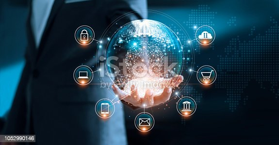 938918098 istock photo Digital marketing. Businessman holding global circle modern interface payments online shopping and icon customer network connection on virtual screen. Data exchanges worldwide. Business innovation technology concept 1052990146