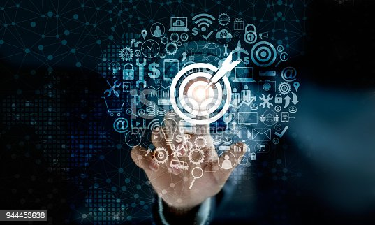 938918098 istock photo Digital marketing. Businessman touching darts aiming at the target center with icon network connection. Business goal and technology concept 944453638