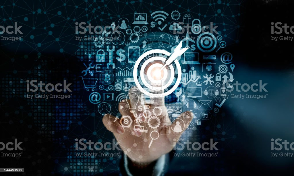Digital marketing. Businessman touching darts aiming at the target center with icon network connection. Business goal and technology concept stock photo