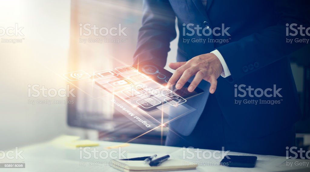 Digital marketing. Businessman using modern interface payments online shopping and icon customer network connection on virtual screen. Business innovation technology concept Digital marketing. Businessman using modern interface payments online shopping and icon customer network connection on virtual screen. Business innovation technology concept Adult Stock Photo