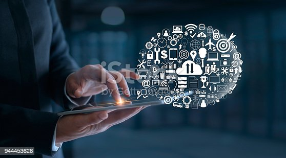 938918098 istock photo Digital marketing. Businessman using tablet with icon network connection. Business innovation technology concept 944453626