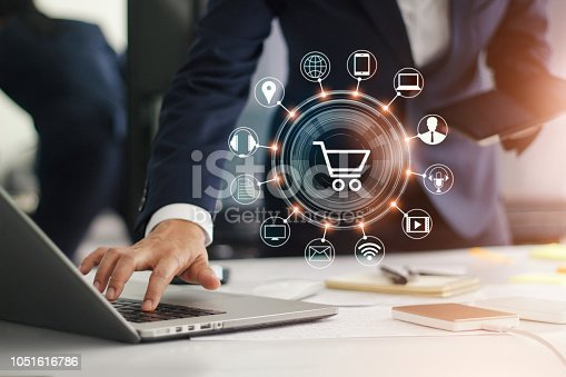 938918098 istock photo Digital marketing. Businessman working with laptop computer, tablet and smart phone. Modern interface payments online shopping and icon customer network connection on virtual screen. Business innovation technology concept. 1051616786