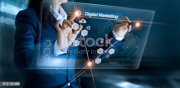 istock Digital marketing. Businesswoman using and drawing global structure networking on modern interface payments online shopping. Icon customer network connection on virtual screen. Plan and strategy. Business innovation technology concept 973130488