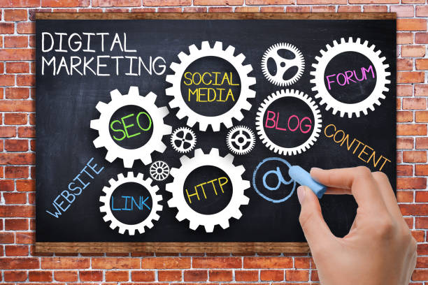 digital marketing concept with spinning gears on blackboard - digital marketing stock pictures, royalty-free photos & images