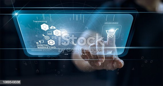 istock Digital marketing. Man using modern interface for online shopping payment and icon customer network connection on virtual screen. Futuristic technologies. Digital lifestyle. Business innovation technology concept. 1069549338