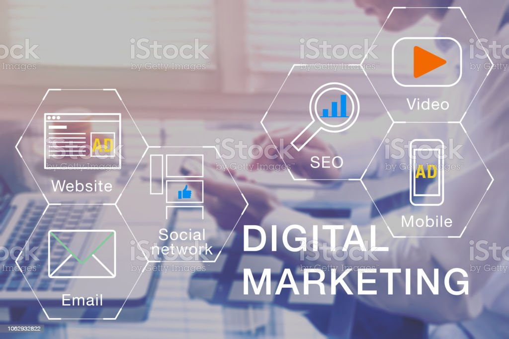 Digital Marketing manager working on social media network, internet website, mobile and email advertisement communication campaign with SEO and pay per click return on investment strategy stock photo