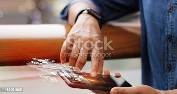 istock Digital marketing media and mobile payments. Businessman working with mobile smartphone and icon network connection on virtual screen. Online banking. Business and modern technology. 1165051905