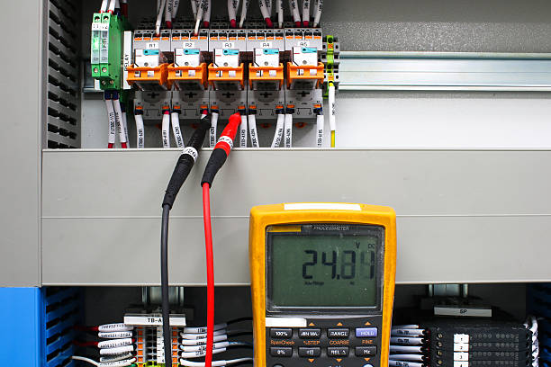 Digital multimeter checking voltage stock photo