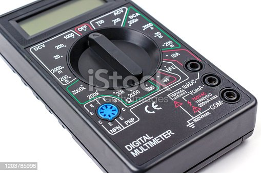 693910734 istock photo Digital multimeter in black plastic case close-up on a white background 1203785998