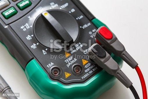 693910734 istock photo Digital multimeter, measurement tool closeup 827910004