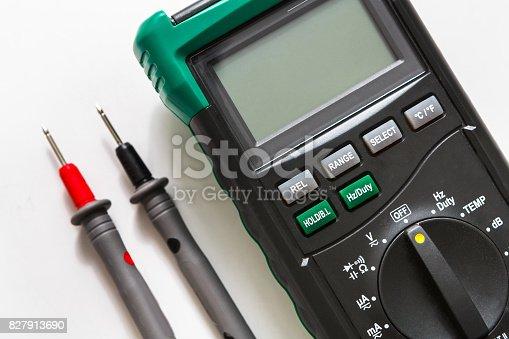 693910734 istock photo Digital multimeter, measurement tool closeup 827913690