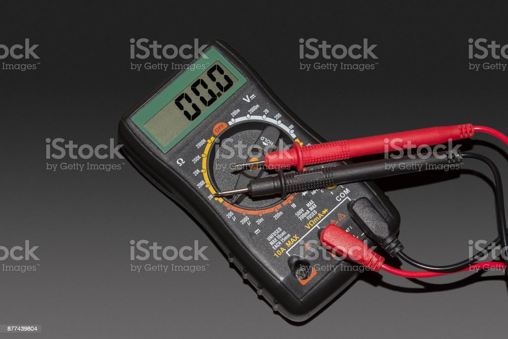 digital multimeter on a black background stock photo
