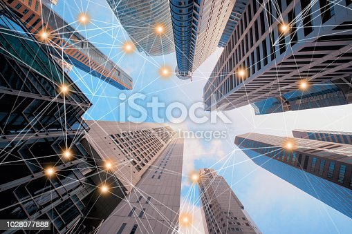 istock Digital network connection lines of architectures, skyscraper buildings in Singapore City with blue sky. 1028077888