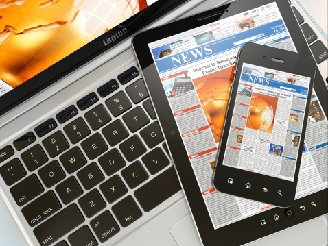 Digital News Laptop Mobile Phone And Tablet Pc Stock Photo - Download Image Now