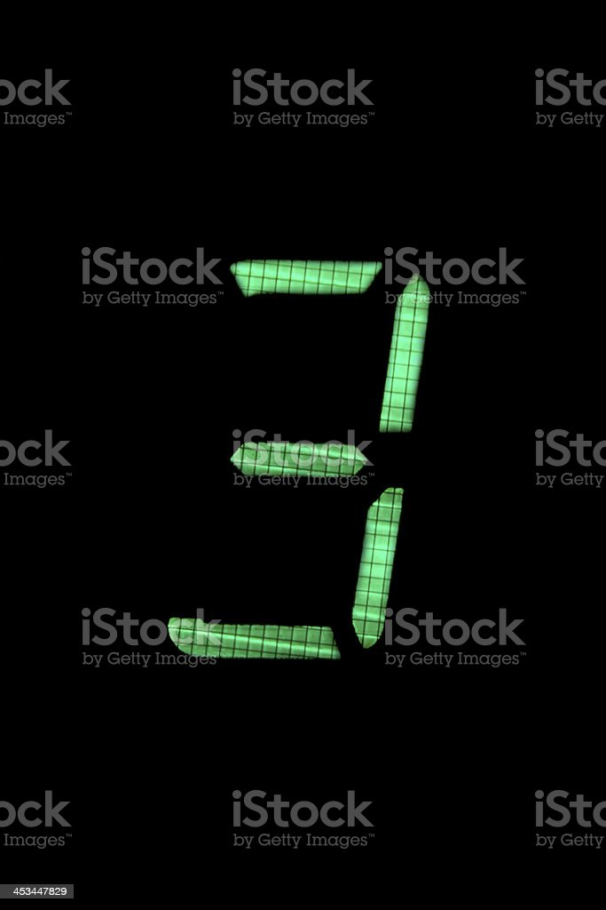 digital number three in green on black background stock photo
