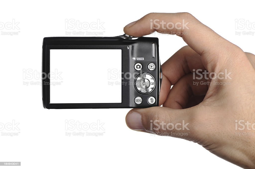Digital photo camera in a men hands royalty-free stock photo
