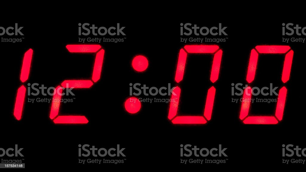 Digital reading of 12:00 on a clock stock photo