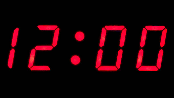 Digital reading of 12:00 on a clock Digital clock reading 12:00 midnight stock pictures, royalty-free photos & images