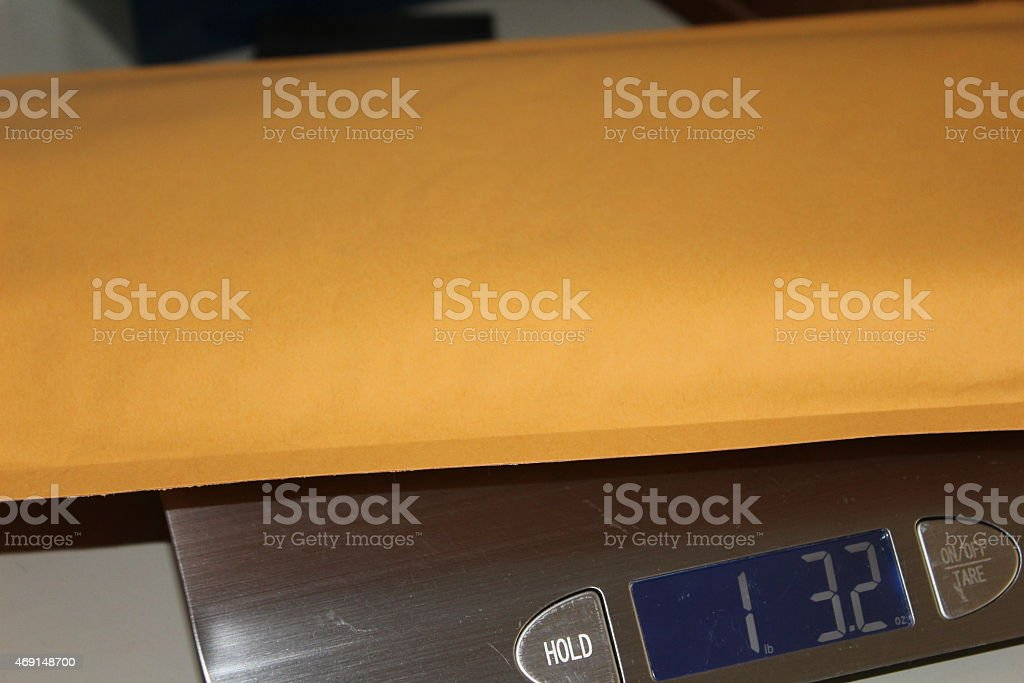 Digital scales with large bubble envelope stock photo
