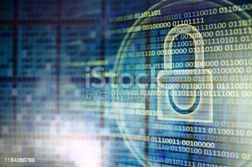digital security computer concepts. White light padlock symbol and lines of binary code on monitor screen double exposure with out of focus grid shape digital panel