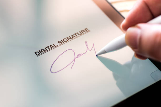 digital signature concept with tablet and stylus pen - electronics industry stock pictures, royalty-free photos & images
