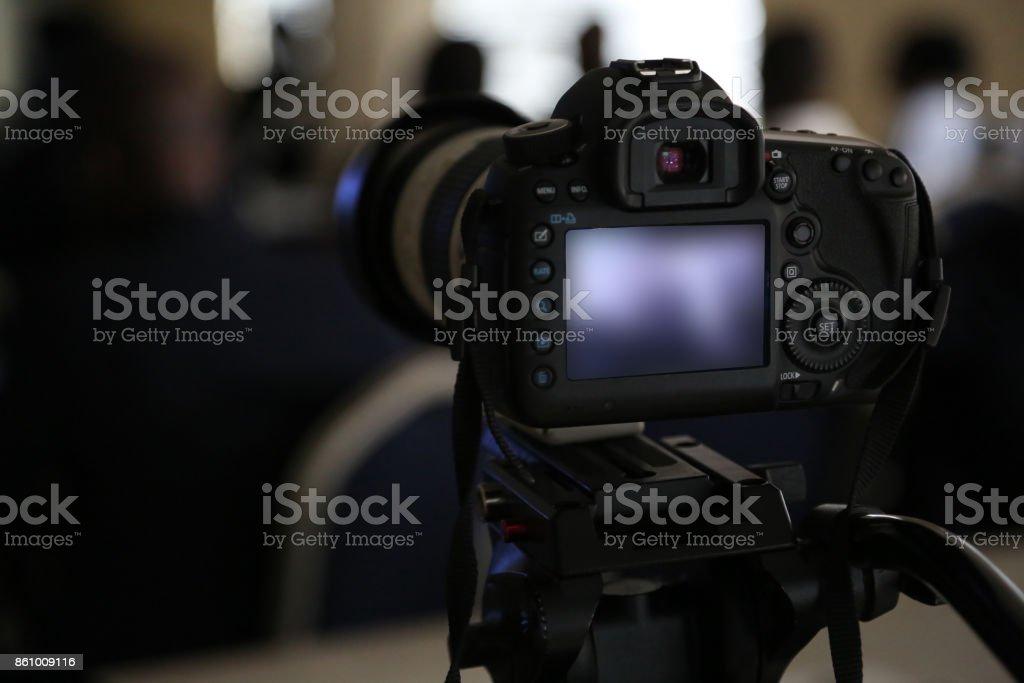 Digital SLR Camera on Tripod stock photo