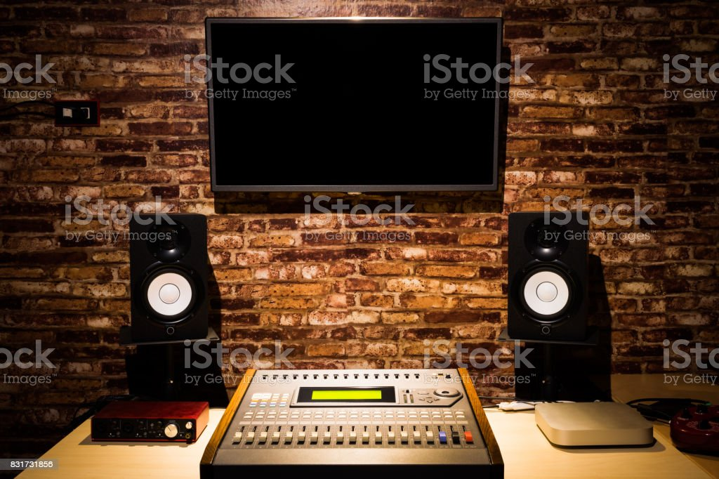 digital sound mixer, monitor speakers & LED screen in recording...