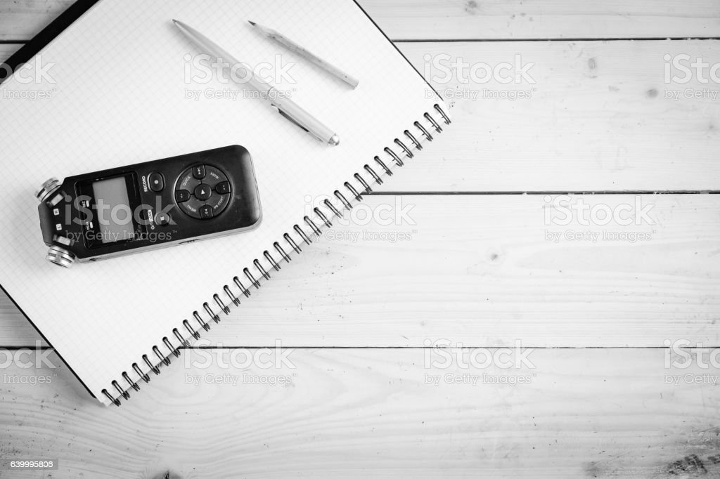 Digital sound recorder and other accessories on the wooden table stock photo