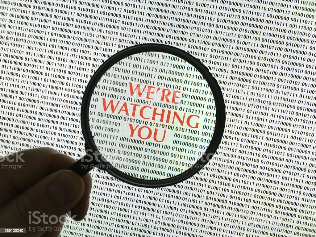 Digital Surveillance computer screen with loupe stock photo
