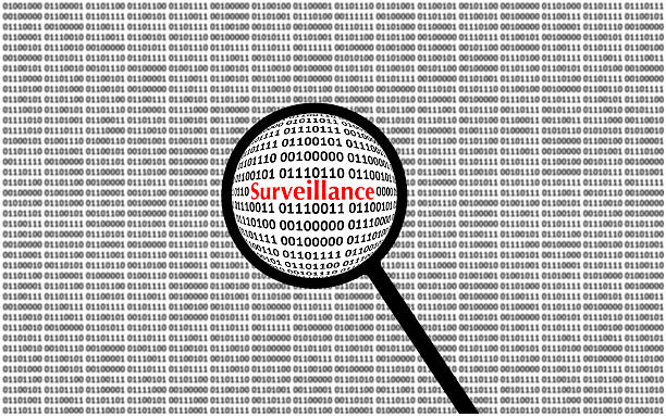 Digital Surveillance loupe and computer screen stock photo